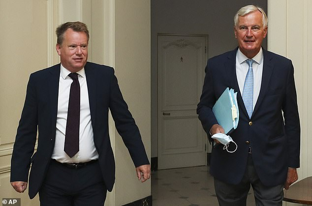 Michel Barnier, right, and David Frost pictured arriving for Brexit trade talks last month