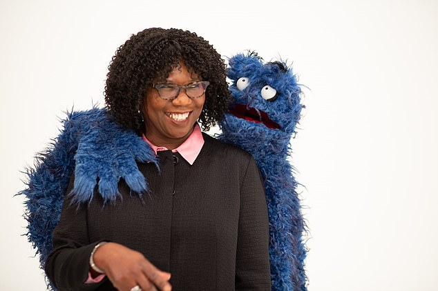 PUPPET POWER: Femi Otitoju with 'UB' puppet, that is said to be used in the 'unconscious bias' training given to MPs in a course designed byChallenge Consultancy