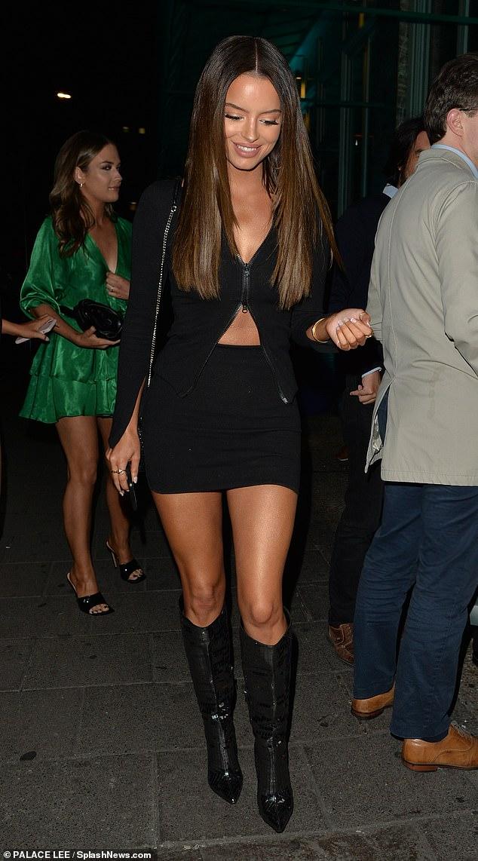 Love Island's Maura Higgins puts on a very leggy display in a black mini skirt