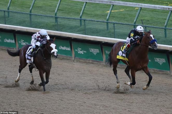 Authentic (right) ridden by jockey John Velazquez runs down the stretch to win the 146th running of the Kentucky Derby at Churchill Downs, defeating a late charge from favorite Tiz the Law