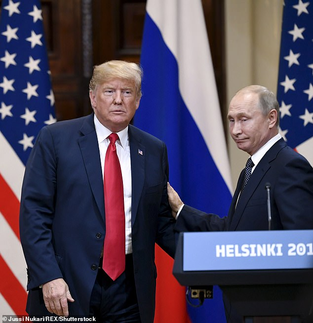 Pictured:Donald Trump (left) and Vladimir Putin (right) at the Presidential Palace in Helsinki during a press conference Helsinki Summit, Finland, on July 16, 2018