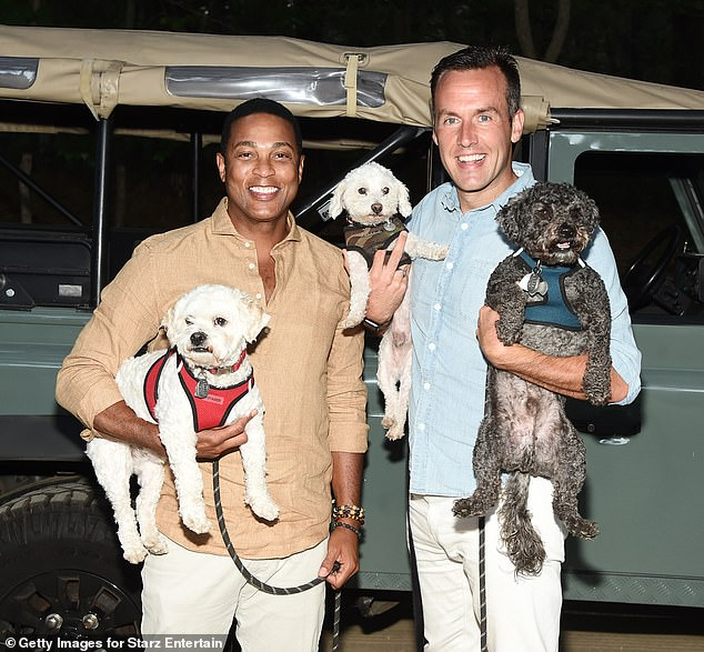 Family pouting: CNN anchor Don Lemon and his husband Tim Malone couldn't resist showcasing some of their for-legged family members