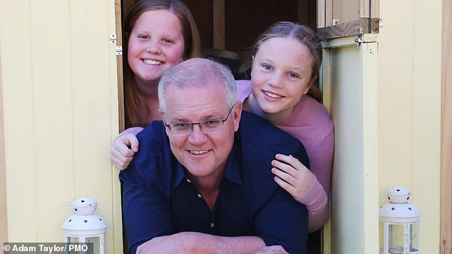 Scott Morrison poses with his daughters Lily and Abby