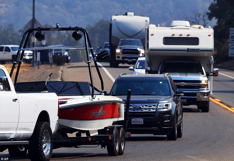 Traffic comes to a stop at Highway CA-168 and Lodge Road as people are evacuated and roads closed because of a wildfire Saturday in Sierra National Forrest
