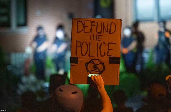 A group of anti-racism protester gathered outside the home of Pittsburgh Mayor Bill Peduto after criminal charges were filed against four protest leaders (pictured)