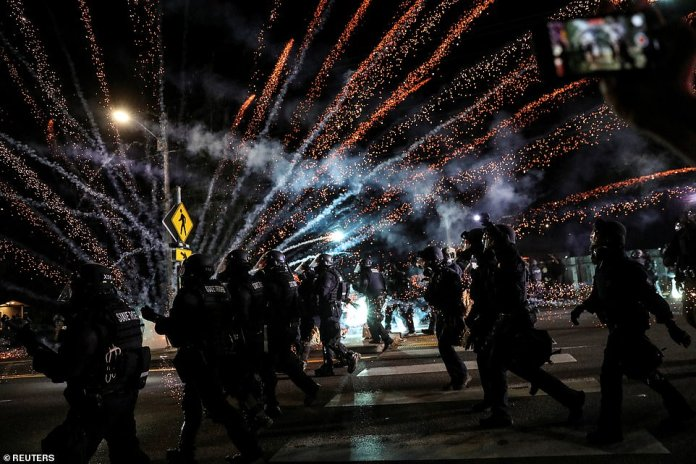 Fireworks and Molotov cocktails were launched on Saturday as law enforcement and anti-racism demonstrators clashed for the 100th night in a row this year