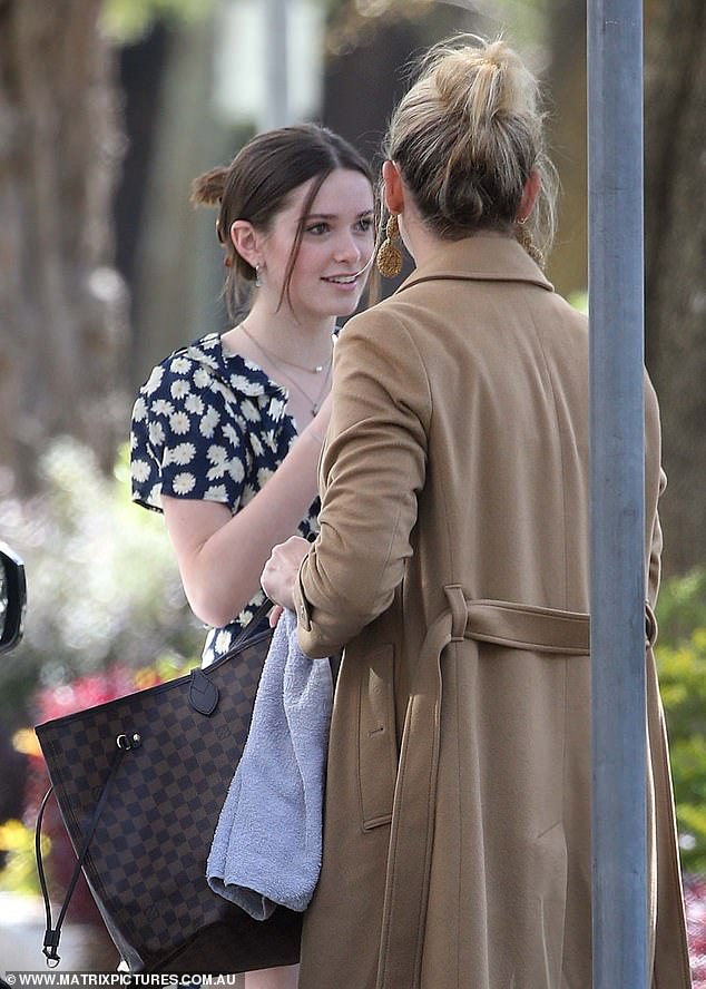 Chit-chat: Jasmine, 36, engaged in friendly conversation with Ava in the streets of Sydney's Double Bay