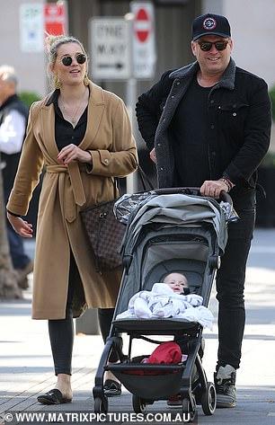 Doting: Karl pushed daughter Harper in her stroller