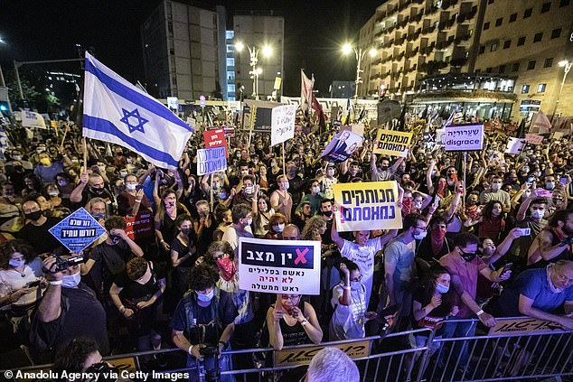Demonstrators gather to stage a protest against Israeli Prime Minister Benjamin Netanyahu, demanding his resignation over corruption cases and his failure to combat the coronavirus pandemic in West Jerusalem on September 5