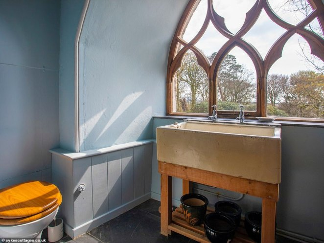 The tower and the estate remained with the Huddart family until 1910, when bankruptcy saw it pass into the hands of the Government. Pictured: The bathroom and its mammoth antique sink