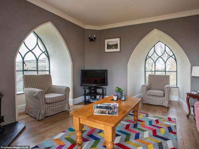 The tower has also been renovated and so has WiFi access, along with a TV and DVD player. Pictured, the living room