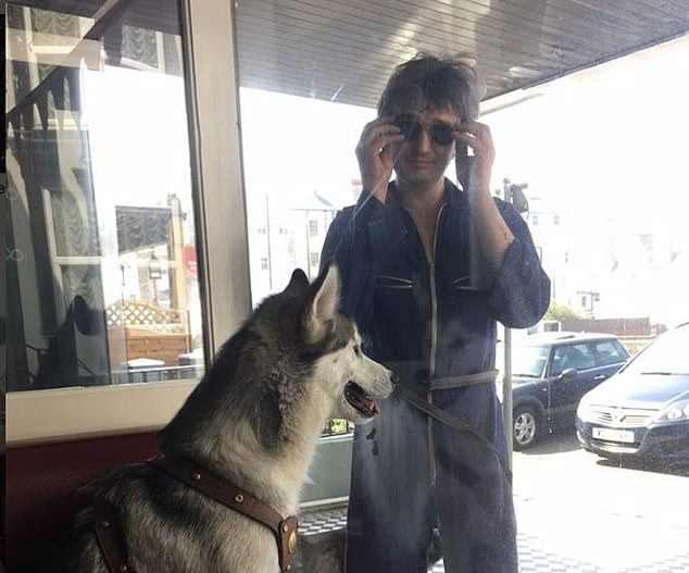 The Libertines musician pictured with one of his dogs. Doherty was riding one of his scooters at night to try and locate one of the pooches who escaped