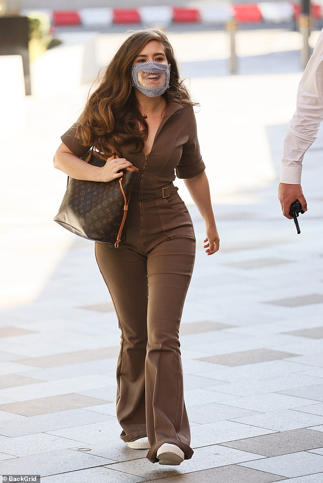 Chic: Rachel Shenton flaunted her curves in a stylish brown jumpsuit and donned a quirky see-through mask as she left the Sunday Brunch studios in London on Sunday