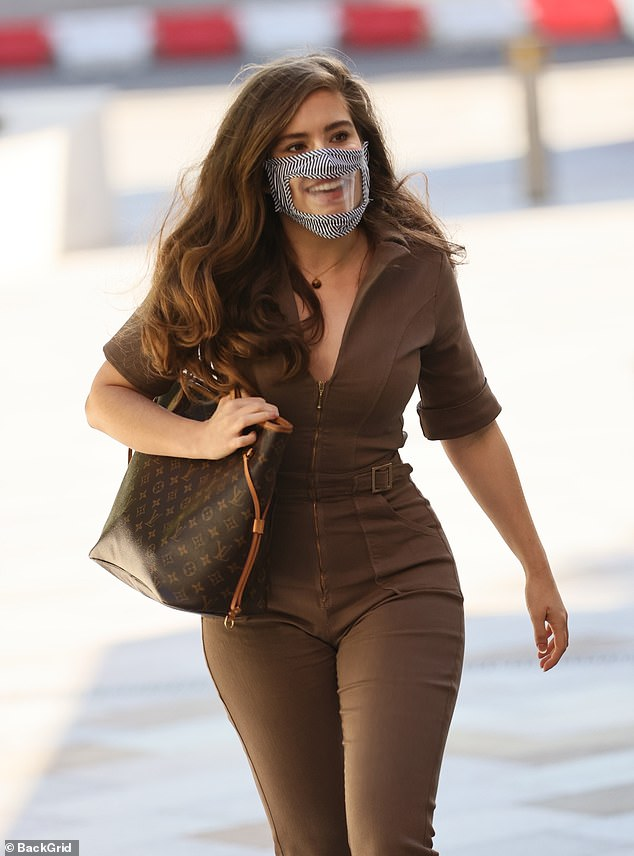 Precautions: The star made sure to put safety first by donning an original zebra print face mask with a sheer section that made her mouth visible