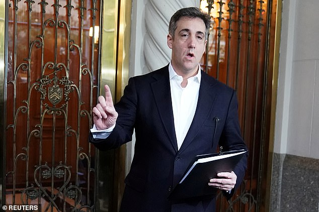 Michael Cohen, U.S. President Donald Trump's former lawyer, speaks to reporters as he leaves his apartment building to report to federal prison in May last year