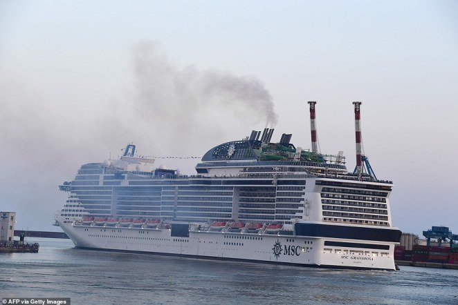 The Italian government gave cruise companies the green light to resume service last month, but limited capacity to 70 percent. The MSC Grandiosa is seen departing from the port of Genoa on August 16