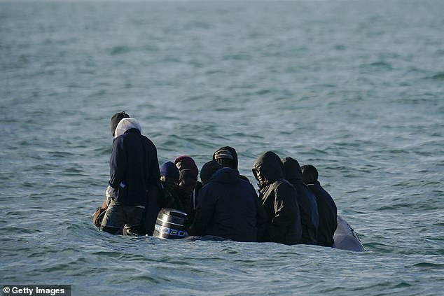 A group of nine migrants drift in the English Channel after their engine failed today