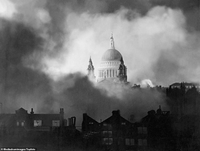 St Paul's Cathedral in London emerges undamaged in full sunlight in the smoke and flames after a bombing raid on Sunday, December 29, 1940. The cathedral became a symbol of hope during the blitz after surviving raid after raid during 1940 even as surrounding buildings were reduced to rubble. During the Battle of Britain, on October 9, the dome of St Paul's was pierced, destroying the altar, but the rest of the cathedral remained intact.Civilian defense brigades, including the St. Paul's Fire Watch, protected the structure from fire, and at one point an unexploded bomb was removed at great risk from the roof of the cathedral