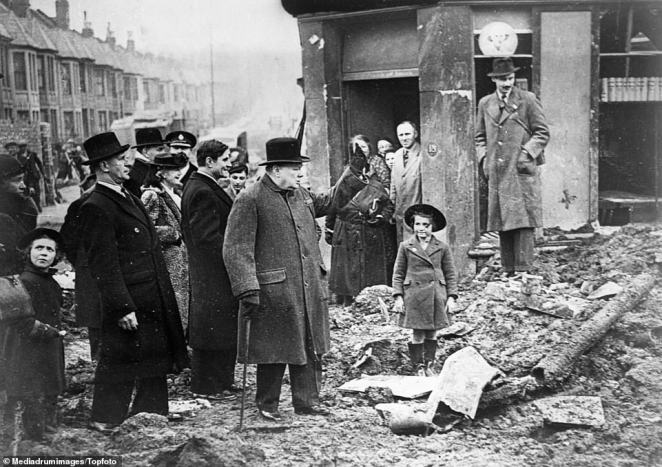 Children line up in the street to watch as war time Prime Minister Winston Churchill walks through London to assess the damage caused by the raids in 1940.During The Blitz, Nazi Germany rained bombs down on Britain for over eight months - killing at least 40,000 people and destroying two-million homes. The German bombing campaign, which started on September 7, 1940, lasted for eight months and five days, with London bearing the brunt of most of the attacks