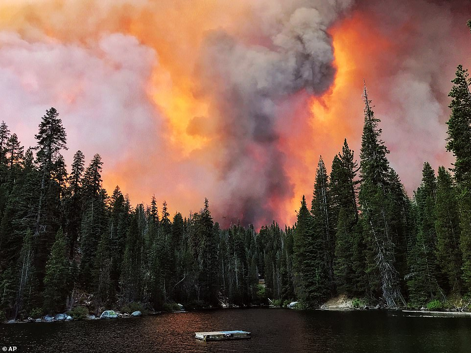 Smoke from the Creek Fire billows beyond a ridge as seen from Huntington Lake on Saturday