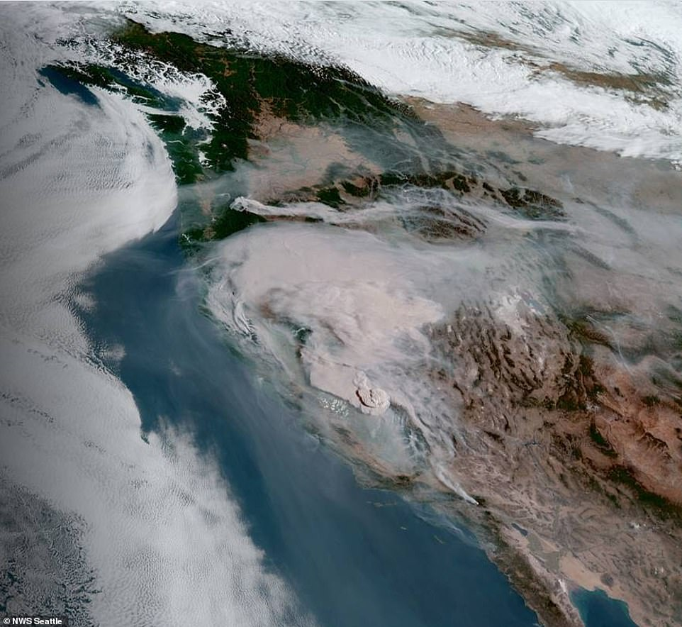 Smoke from the wildfires over California pictured above Sunday