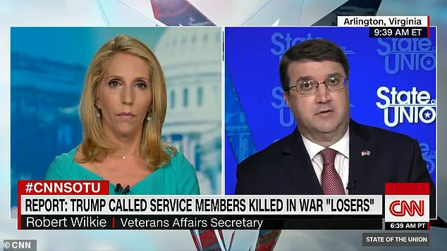 Veteran Affairs Secretary Robert Wilkie (right) has joined a long list of officials in blasting a recent report in the Atlantic that claimed Trump has repeatedly made disparaging remarks about the US war dead, calling them ¿suckers¿ and ¿losers'
