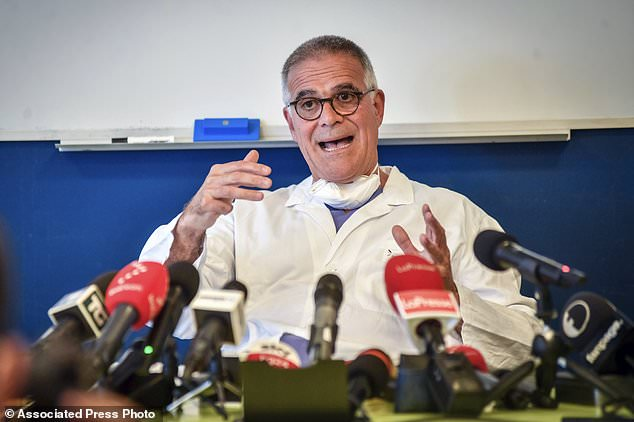 Alberto Zangrillo, Silvio Berlusconi's longtime physician, speaks to reporters at the San Raffaele hospital in Milan on 4 September