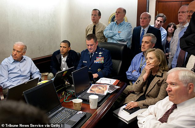 President Barack Obama and Vice President Joe Biden, along with with members of the national security team, receive an update on the mission against Osama bin Laden in the Situation Room of the White House in Washington, DC, May 1, 2011