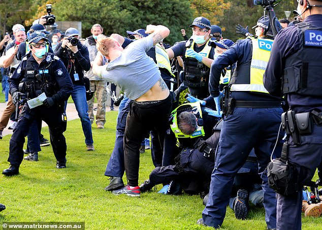 Officers and Melburnians fall to the ground during dramatic arrests from the anti-lockdown protest on Saturday