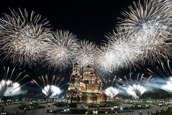 Fireworks explode over the Cathedral of Russian Armed Forces during the Spasskaya Tower military music festival in Kubinka, outside Moscow, as the annual music festival takes place with almost no spectators