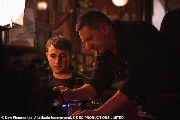 Inspections: A crew member turned on a light on a drink in the pub between filming