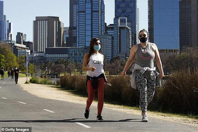 Australia's big banks will this month be demanding 450,000 borrowers prove they can't repay their mortgage even though Melbourne remains in lockdown indefinitely. Pictured are walkers on the Yarra River on September 6, 2020