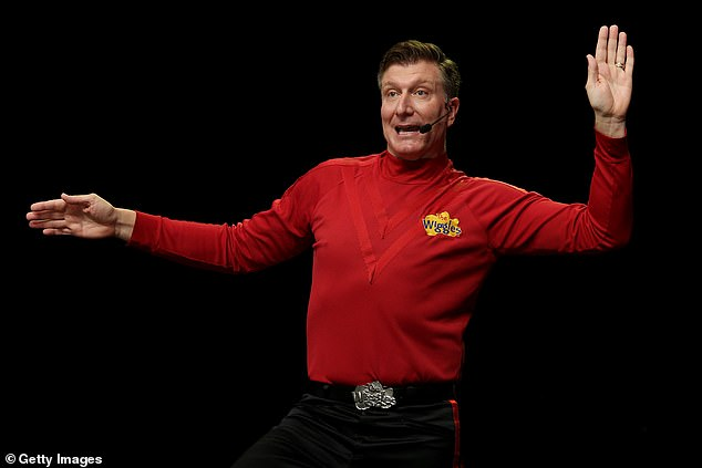 Red-y!'Well, I'll tell you what, I will never complain about wearing a skivvy ever again!' Simon joked. Pictured on stage with The Wiggles
