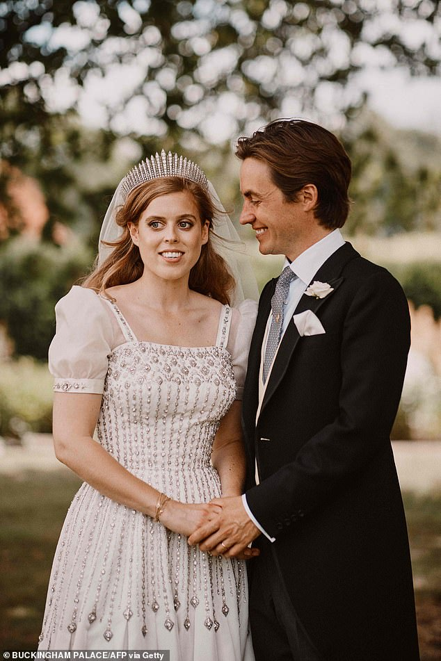 The dresswas altered for Beatrice by the Queen's personal adviser and dresser Angela Kelly and the fashion designer Stewart Parvin. Pictured, with husband Edoardo on their wedding day