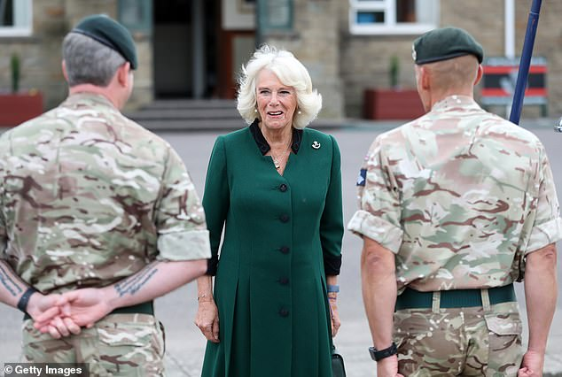 The Duchess smiled broadly as she spoke with soldiers during the visit to the barracks earlier today