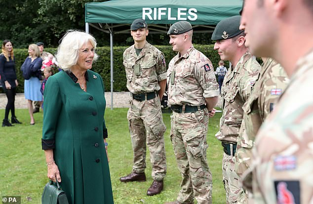 She beamed as she spoke with those currently undergoing training at the barracks in Wales during her visit