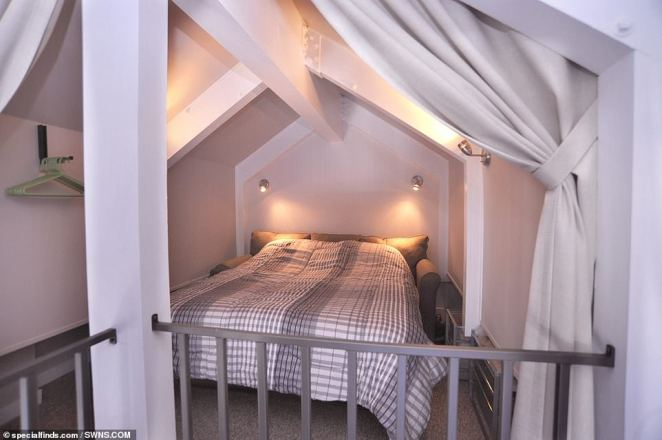 The second bedroom currently boasts a fold-away sofa bed (pictured) which is nestled into the rafters of the luxury houseboat