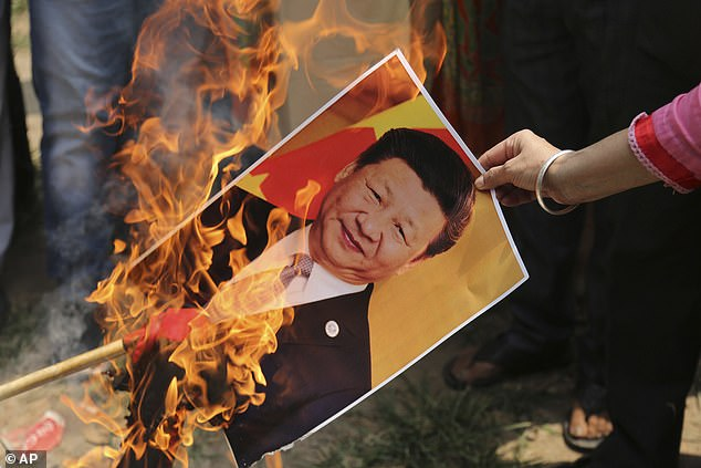Indian protesters burn a poster of Chinese president Xi Jinping in July after a mass brawl which left 20 soldiers dead