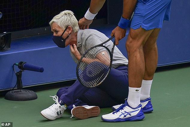 Clark holds her throat after being struck by the stray ball from Djokovic at the US Open