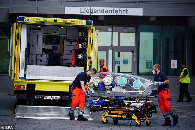 Paramedics are seen at the clinic after the Russian opposition activist arrived at Charite in Berlin, Germany, 22 August