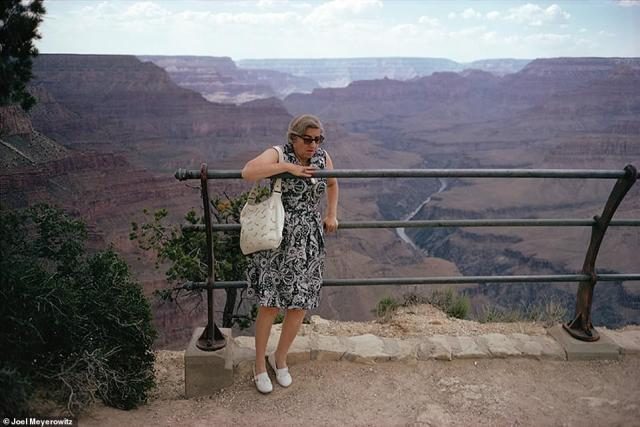 "Throughout his new book, How I Make Photographs, Meyerowitz, who has been a photographer for almost 60 years, offers many lessons, including being open to the unexpected and to humor. He wrote: 'People often ask me, ""How do you make a funny picture?,"" to which I reply that I don't know how ¿ funny pictures just happen.' About the above image, Grand Canyon, 1967, he wrote that he 'was walking along the edge... when I saw a woman weaving herself into the railings where people aren't supposed to go because they might fall thousands of meters. But this crazy lady with her handbag hanging off her shoulder did it anyway'"