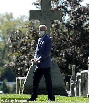 Biden pictured leaving St. Joseph on the Brandywine Roman Catholic Church after attending Sunday services to visit his loved ones' graves