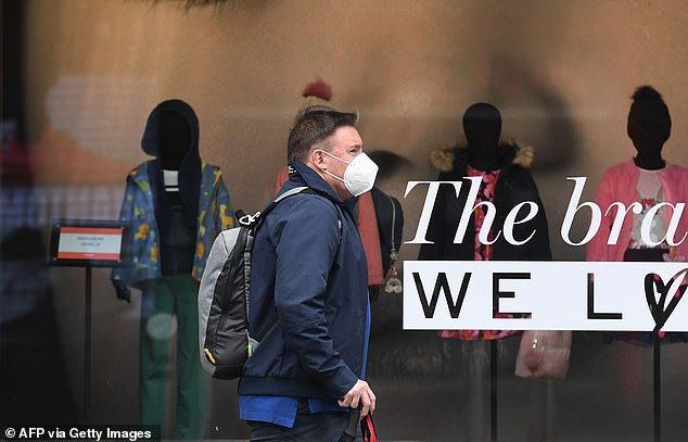 A masked pedestrian walks past a shop display in a deserted Burke Steet Mall in Melbourne's CBD on September 2. New modelling has suggested the city's extended lockdown could cost another 260,000 jobs