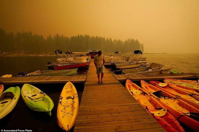 The blaze, dubbed the Creek Fire, has charred nearly 80,000 acres of timber, and the 800 firefighters on the scene had yet to get any containment after more than three days of work on steep terrain in sweltering heat.