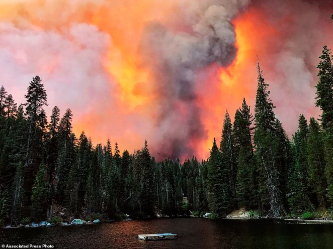 Smoke from the Creek Fire billows beyond a ridge as seen from Huntington Lake on Saturday, September 5