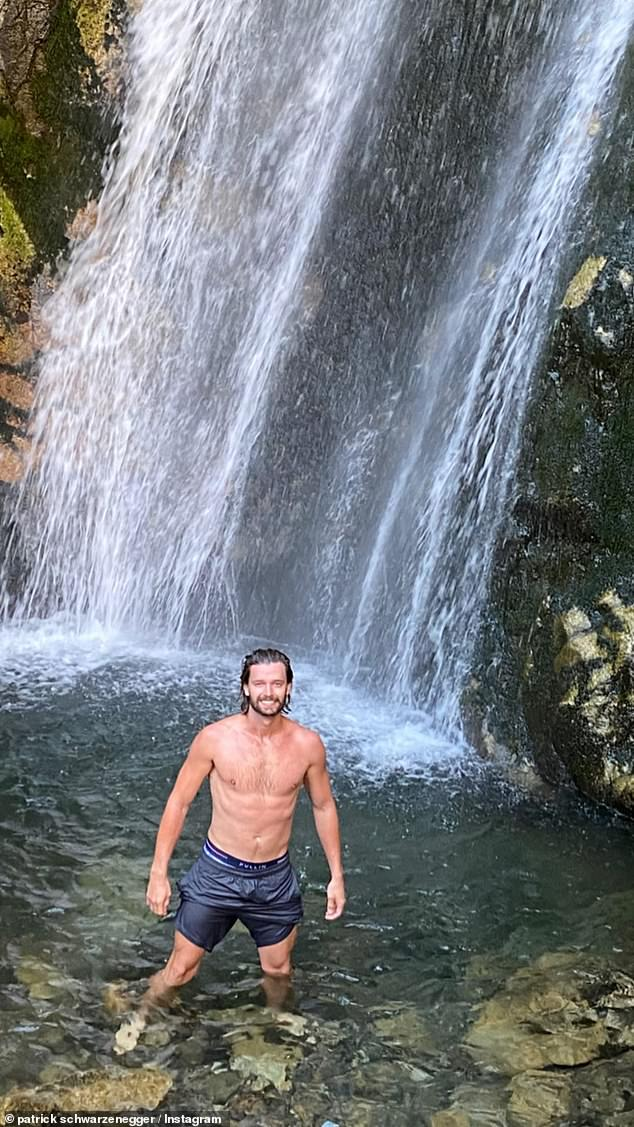 In his boxers and trunks:Patrick Schwarzenegger was seen with his shirt off, showing his toned torso for his fans. The son of Arnold Schwarzenegger and Maria Shriver was by a waterfall