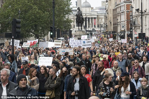 A massive crowd of people took to the streets of London during the protest on August 29. They clutched various signs as they marched to Westminster