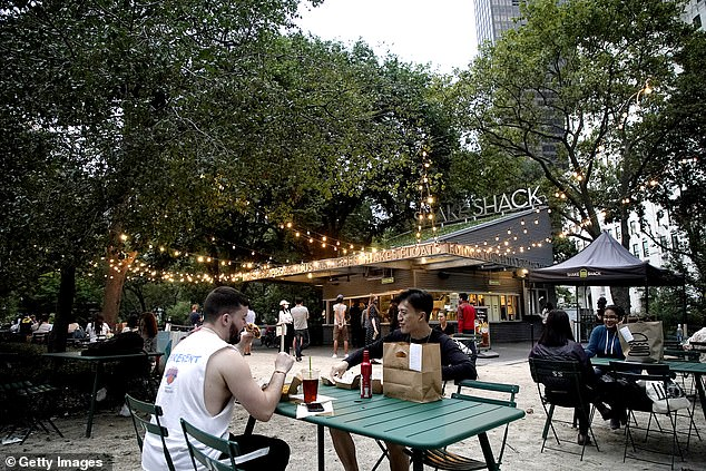 In New York City indoor dining is still banned, but restaurants in other parts of the state allow for it. People enjoying outdoor dining above on August 31 in New York City above