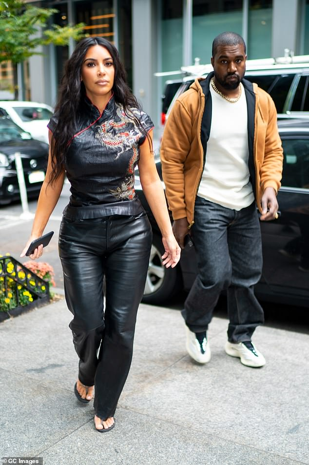 Making it work: Kim Kardashian remaining 'incredibly patient' over husband Kanye West's unlikely bid for presidency (the pair pictured above in October 2019)