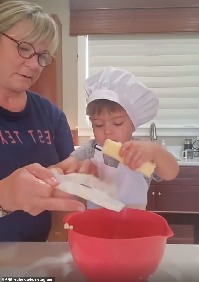 Little chef! Two-year-old Cade is going viral for a video in which he bakes cookies with his grandmother